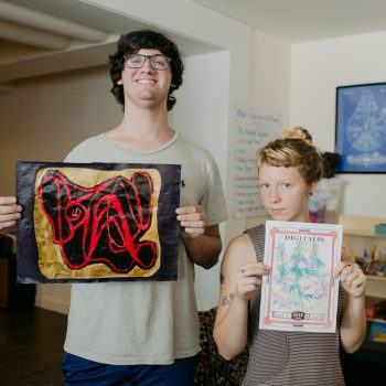 Mansfield Hall - Burlington - Two Students showing off their artwork