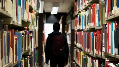Student walking through library