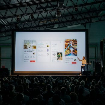 Person giving presentation on screen
