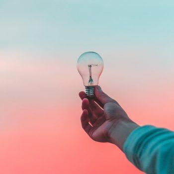Person holding lightbulb